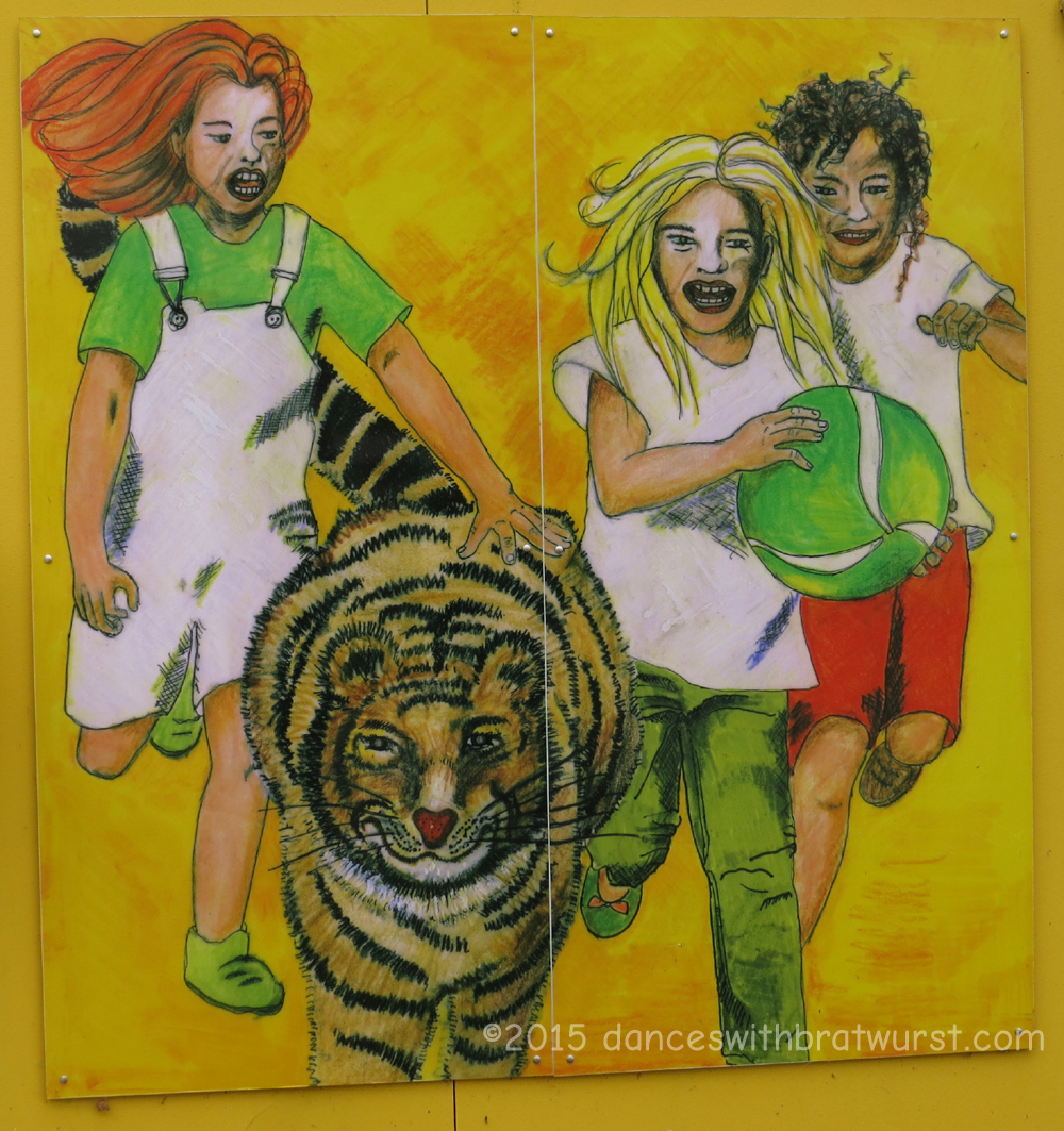 ...not sure what the kids are planning to do with the tiger when they catch him, but it can't be good.