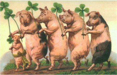Glücksschweine mit vierblättrige Kleeblätter
