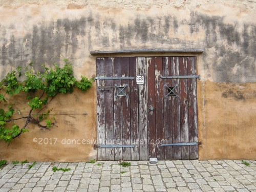 Door outside the wall.